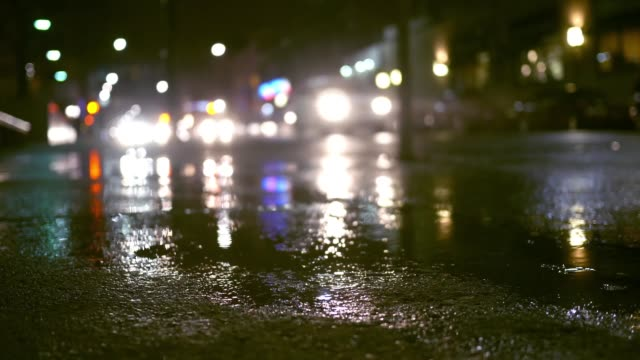 Rainy evening with traffic in urban city area - suspense style filler shot Rainy evening with traffic in urban city area - suspense style filler shot shallow stock videos & royalty-free footage