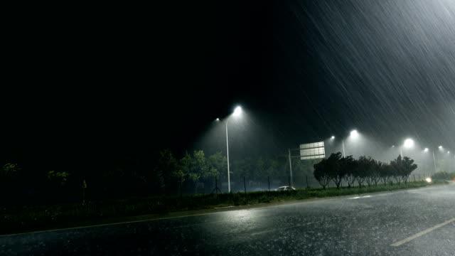 rainy street at night - asta oggetto creato dall'uomo video stock e b–roll