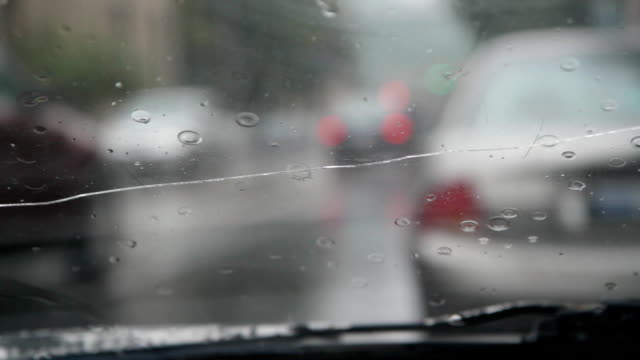 Rainy traffic. Cracked windshield. video