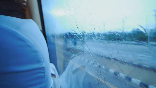 Rainy window in traffic . video