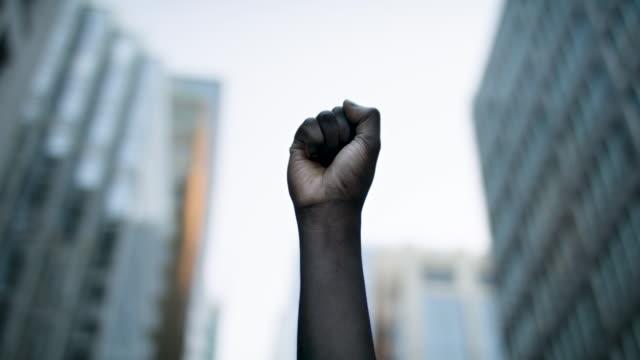 Raised black man's fist in protest.