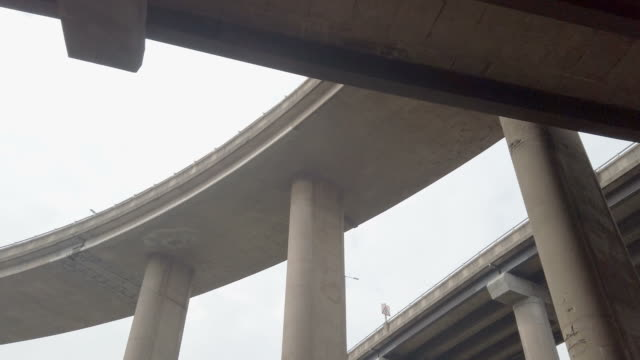 Raised motorway roads - Spaghetti Junction. Part of the Gravelly Hill interchange in Birmingham, England. Known as Spaghetti Junction. Seen from beneath. civil engineering stock videos & royalty-free footage