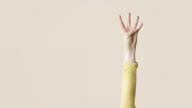 Raised up hands and fingers showing numerical video