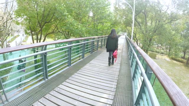 Raised wooden walkway in Xujiahui park Shanghai.
