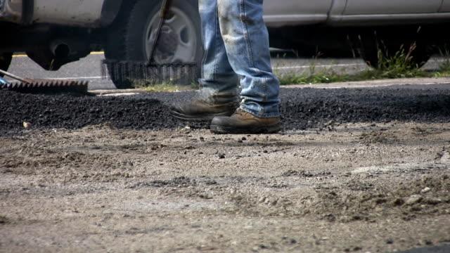 Raking hot asphalt. video