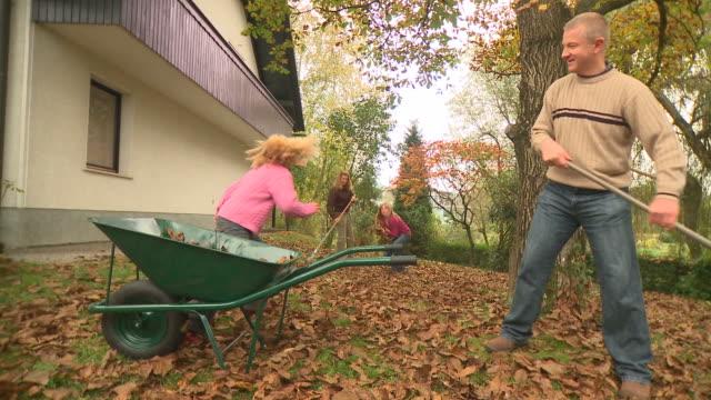 hd dolly: raking leaves - working from home bildbanksvideor och videomaterial från bakom kulisserna