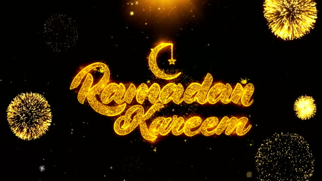 ramadan kareem text wish on firework display explosion particles. - фанус стоковые видео и кадры b-roll