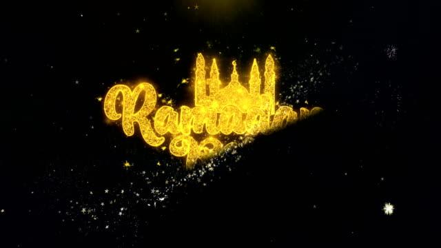 ramadan kareem text wish on gold particles fireworks display. - фанус стоковые видео и кадры b-roll