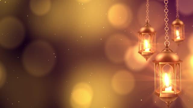 vídeos y material grabado en eventos de stock de linterna de ramadán colgando sobre el fondo bokeh. - eid mubarak
