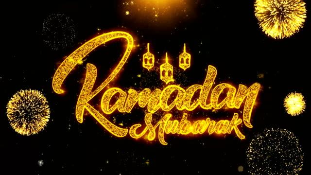 ramadan mubarak text wish on firework display explosion particles. - фанус стоковые видео и кадры b-roll