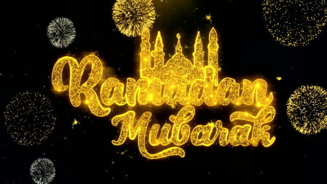 ramadan mubarak text wish on gold particles fireworks display. - фанус стоковые видео и кадры b-roll
