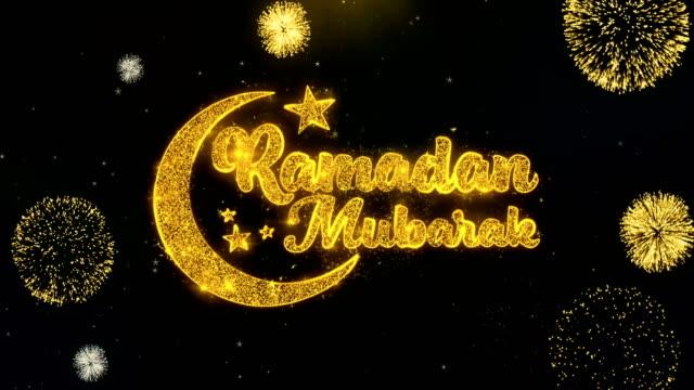 ramadan mubarak text wish on gold particles fireworks display. - ramadanowa latarnia filmów i materiałów b-roll