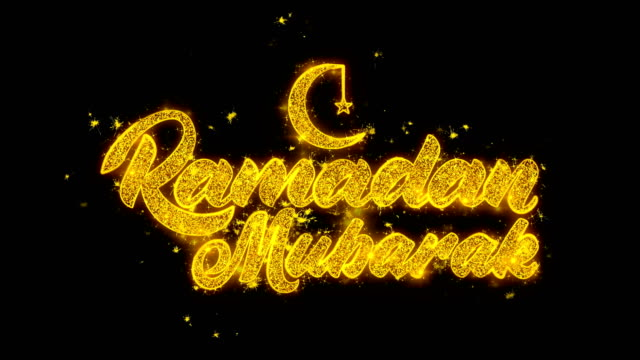 ramadan mubarak wish text sparks particles on black background. - фанус стоковые видео и кадры b-roll