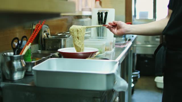 Ramen Chef Serving Noodles into Bowls