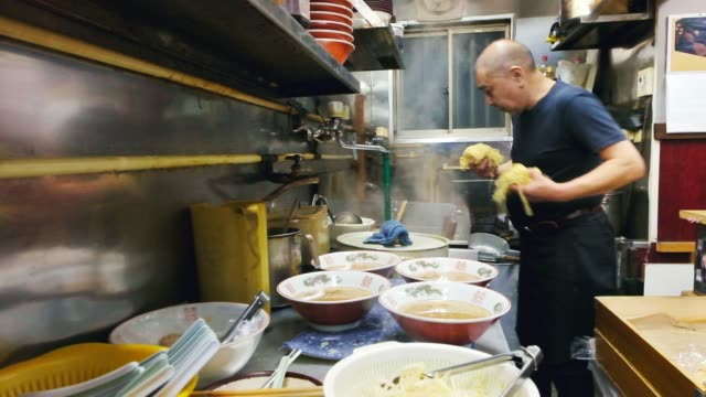 Ramen Shop in Tokyo Japan The owner of a one man ramen shop in Tokyo Japan serves the customers at the counter. small business saturday stock videos & royalty-free footage