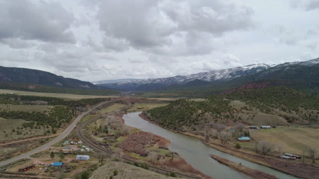 Ranches in Colorado Mountains nearby McCoy and Colorado River, in the early spring. Aerial drone video with the backward camera motion.