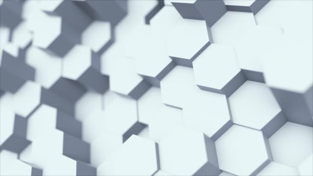 六角形の幾何学的な表面のループからのランダム振っモーション抽象的な背景: 光明るいクリーン最小限の六角形のグリッドパターン、純粋な壁の建築白でキャンバス。シームレスループ cg 3 - 彫刻点の映像素材/bロール