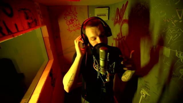 Rap musician in studio singing