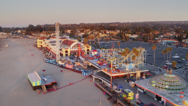 Rapid Drone Flight Over Santa Cruz Beach and Boardwalk at Sunrise