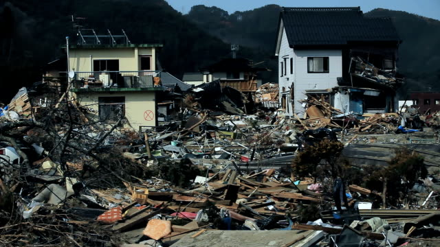 Ravaged city after the tsunami, a lot of trash in the street Destroyed buildings and houses after the tsunami in Japan. City of Fukushima is ravaged after the disaster. No one in the town, an evacuate city. A lot of dust and trash. earthquake stock videos & royalty-free footage