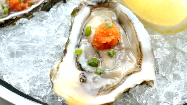 Raw and fresh oyster shell with lemon video