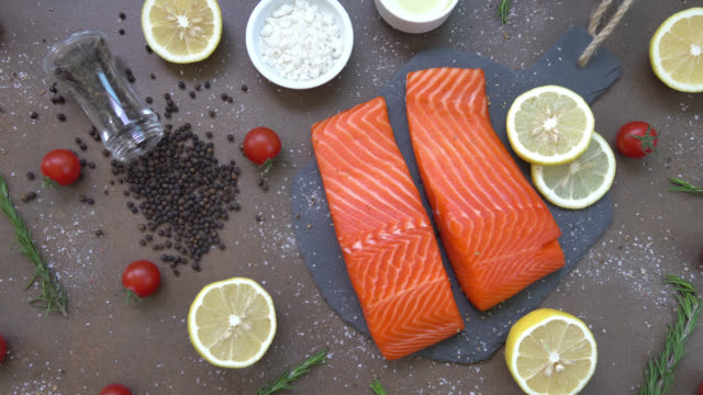 raw and fresh salmon meat fillet - filetto video stock e b–roll