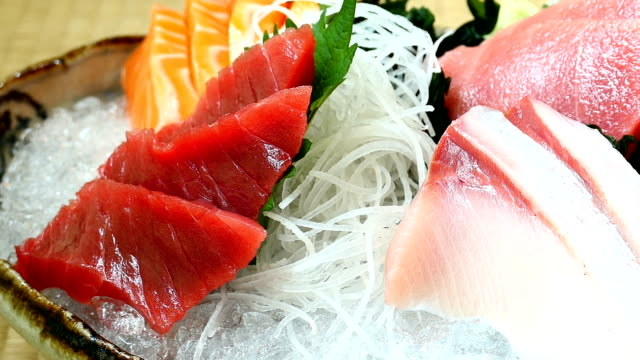 Raw and fresh salmon tuna and other sashimi fish meat video