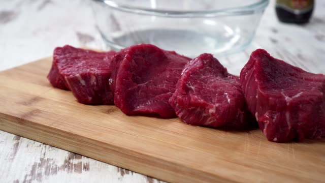 raw beef meat, preparing for cooking video