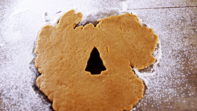 Raw cookie dough with christmas tree shaped hole 4k video