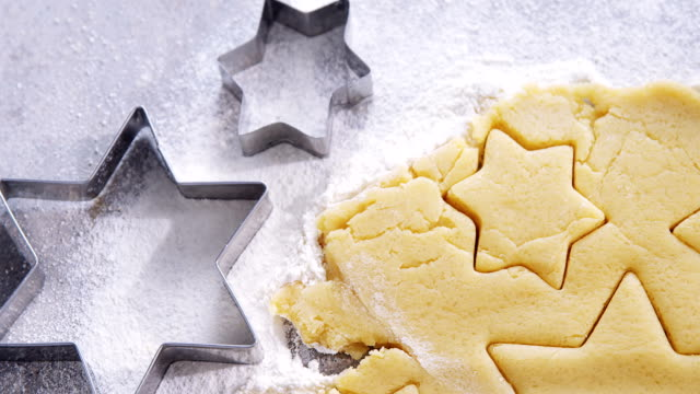 Raw cookie dough with star shape and cutter 4k video