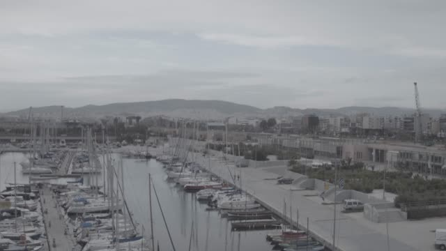 Raw footage - Aerial - Drone - flying into a marina at Faliro Bay - Athens, Greece video