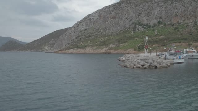 Raw footage - Aerial - Drone - Leros Island - Aegean Sea - Dodecanese - rightway flight and reveale of a small harbor video