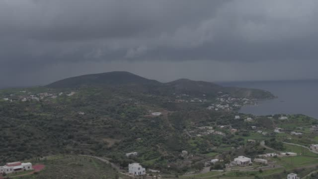Raw footage - Aerial - Drone - Leros Island - Aegean Sea - Dodecanese - straight flight over a traditional town in Leros Island, in stormy weather at  winter video