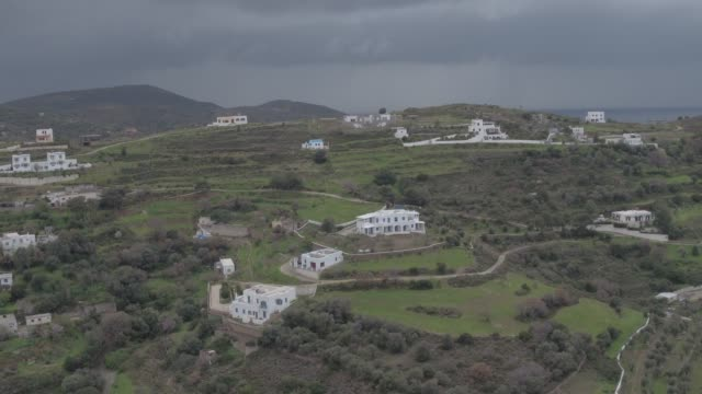 Raw footage - Aerial - Drone - Leros Island - Aegean Sea - Dodecanese - straight flight over a homes and hills in Leros Island, in stormy weather at  winter video