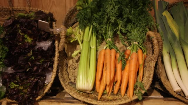Raw fresh vegetables assortment on counter Raw fresh vegetables assortment on counter in supermarket carrot stock videos & royalty-free footage