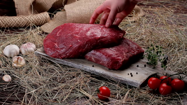 Raw meat on a wooden board. video
