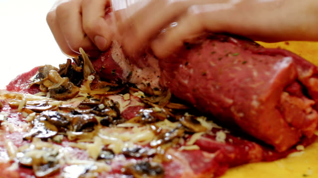 Raw meat , roll.Close-up video