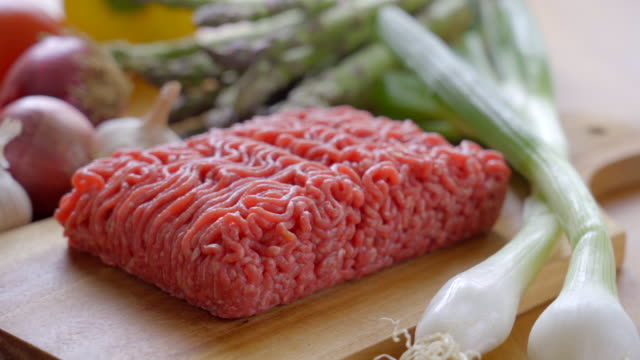 Raw Minced Beef on a Cutting Board in the Kitchen