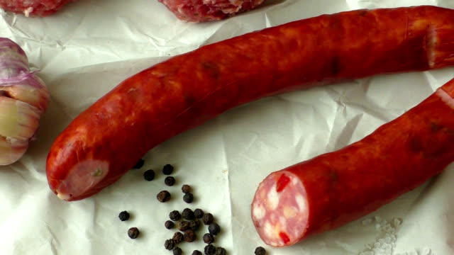 Raw minced hamburger meat with herb and spice prepared for grilling video