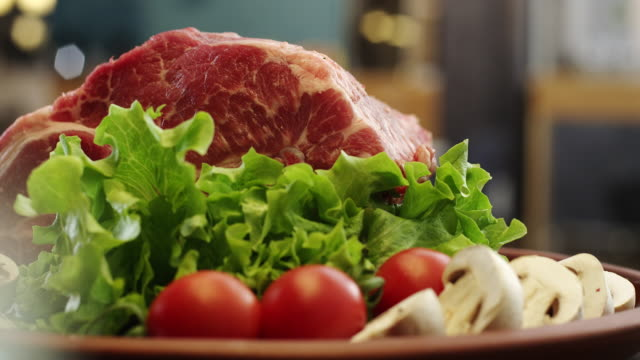Raw pork meat on plate video