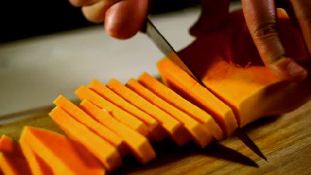 Raw pumpkin cut. Healthy food. Cutting fresh pumpkin. Pumpkin sliced video