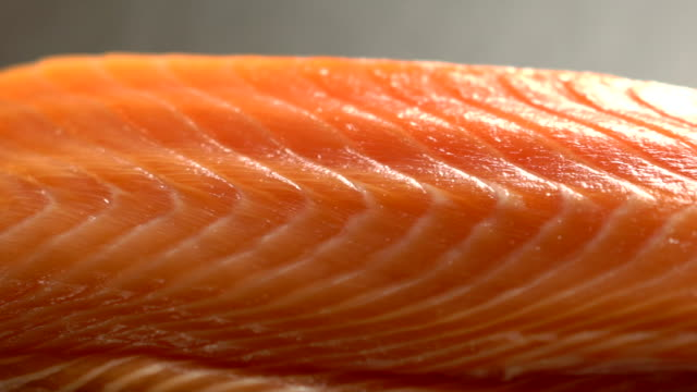 raw salmon in kitchen bar at the japanese restaurant - sashimi video stock e b–roll