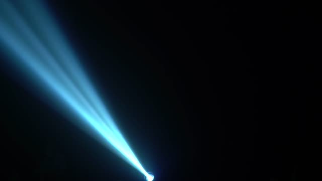Ray of light at a concert on a black background Ray of light at a concert on a black background in smoke laser stock videos & royalty-free footage