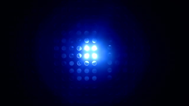 Rays of blue color from searchlight throughe lattice video