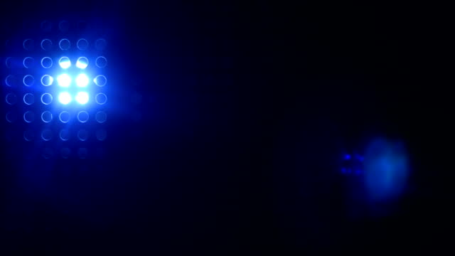 Rays of blue color from the searchlight through video