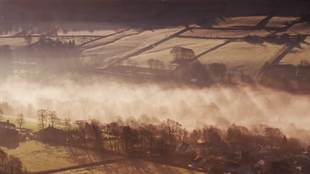Rays of Sunlight on Morning Fog in West Yorkshire - Drone Shot video
