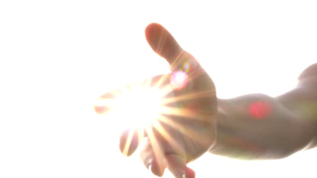 reaching helping hand with brightness, blessing, god, angel - angelo video stock e b–roll