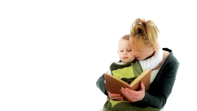 Reading a book. Mother and her daughter. Bedtime story. Storybook. video