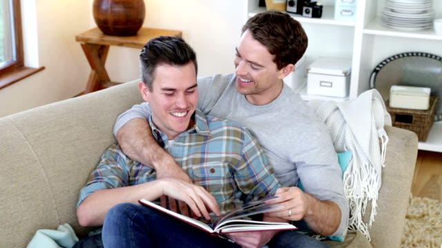 reading at home - same sex couples stock videos and b-roll footage