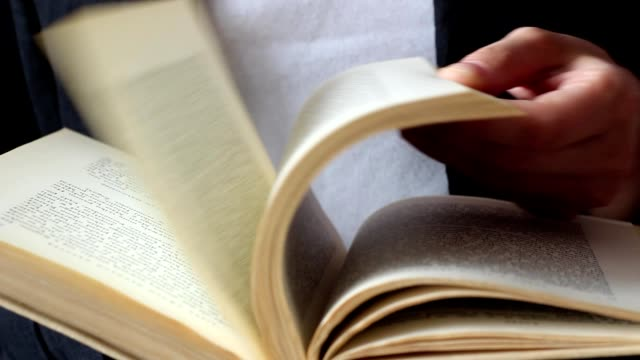 reading book, turning pages video